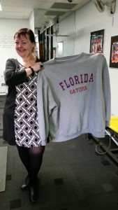 Janine now holding a sweatshirt that shows how far her weight loss has come!